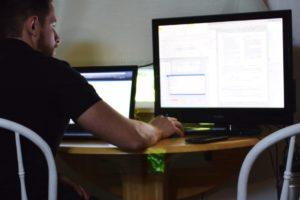 a-man-at-work-at-the-multiscreen-workstation-compu-K9RJ3XT