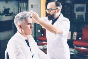 barber-hairdressing-a-customer-PG26RUG