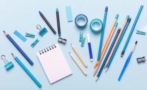 flat-lay-of-office-school-stationery-on-blue-backg-EPMNCBH